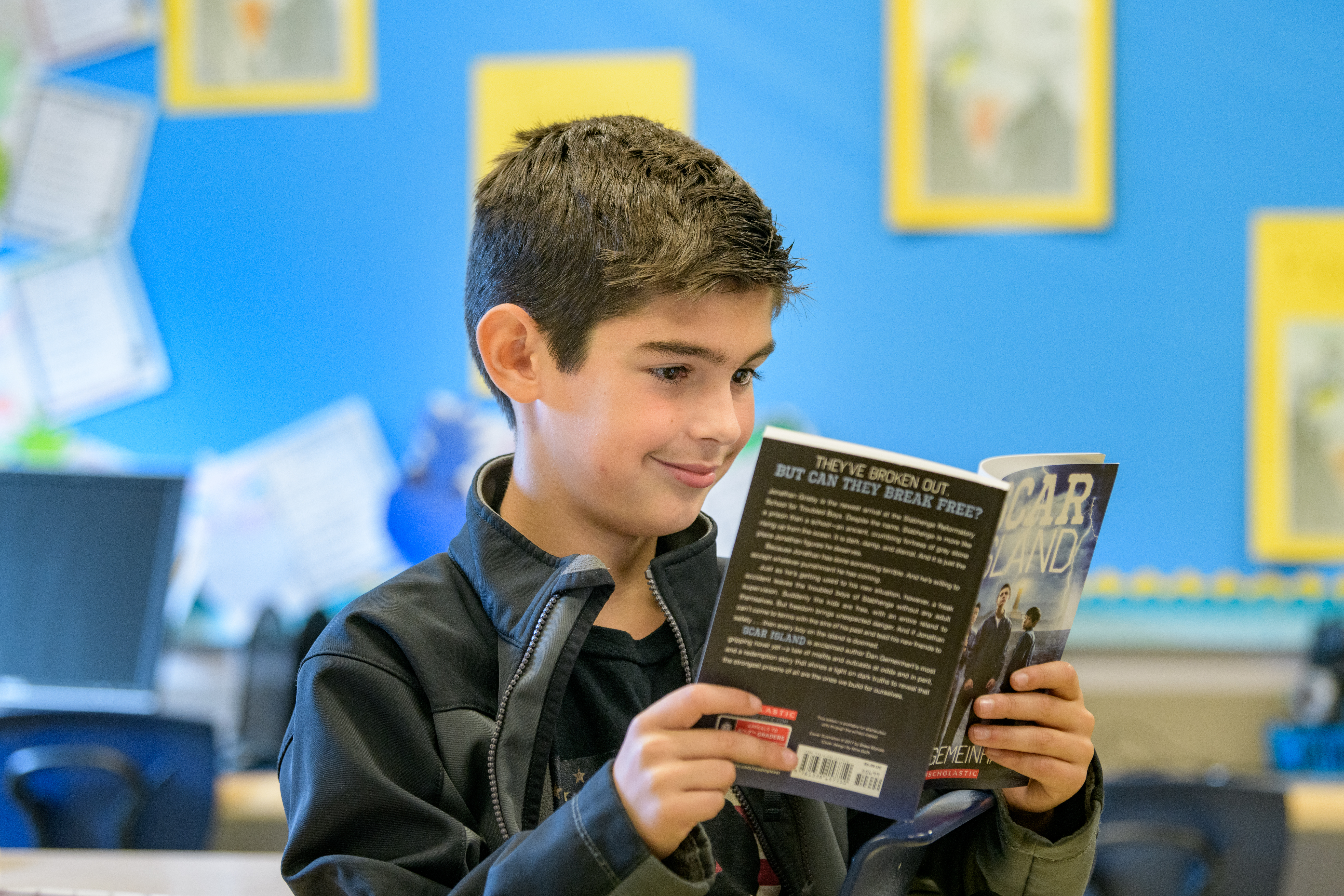 Student reads book in class at The College School