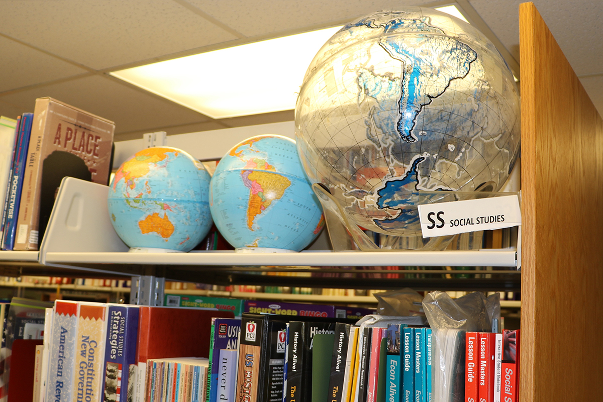 Globes and books in the Education Resource Center at UD