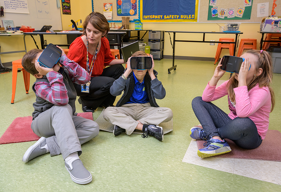 Students at The College School use virtual reality glasses