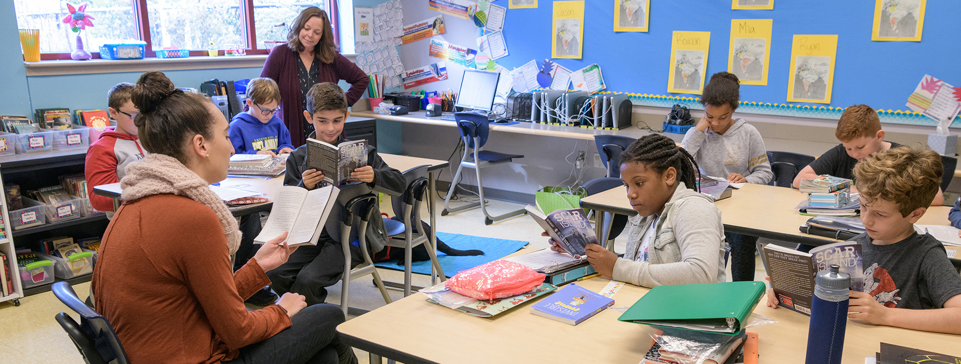 Student teacher reads to classroom of students at The College School