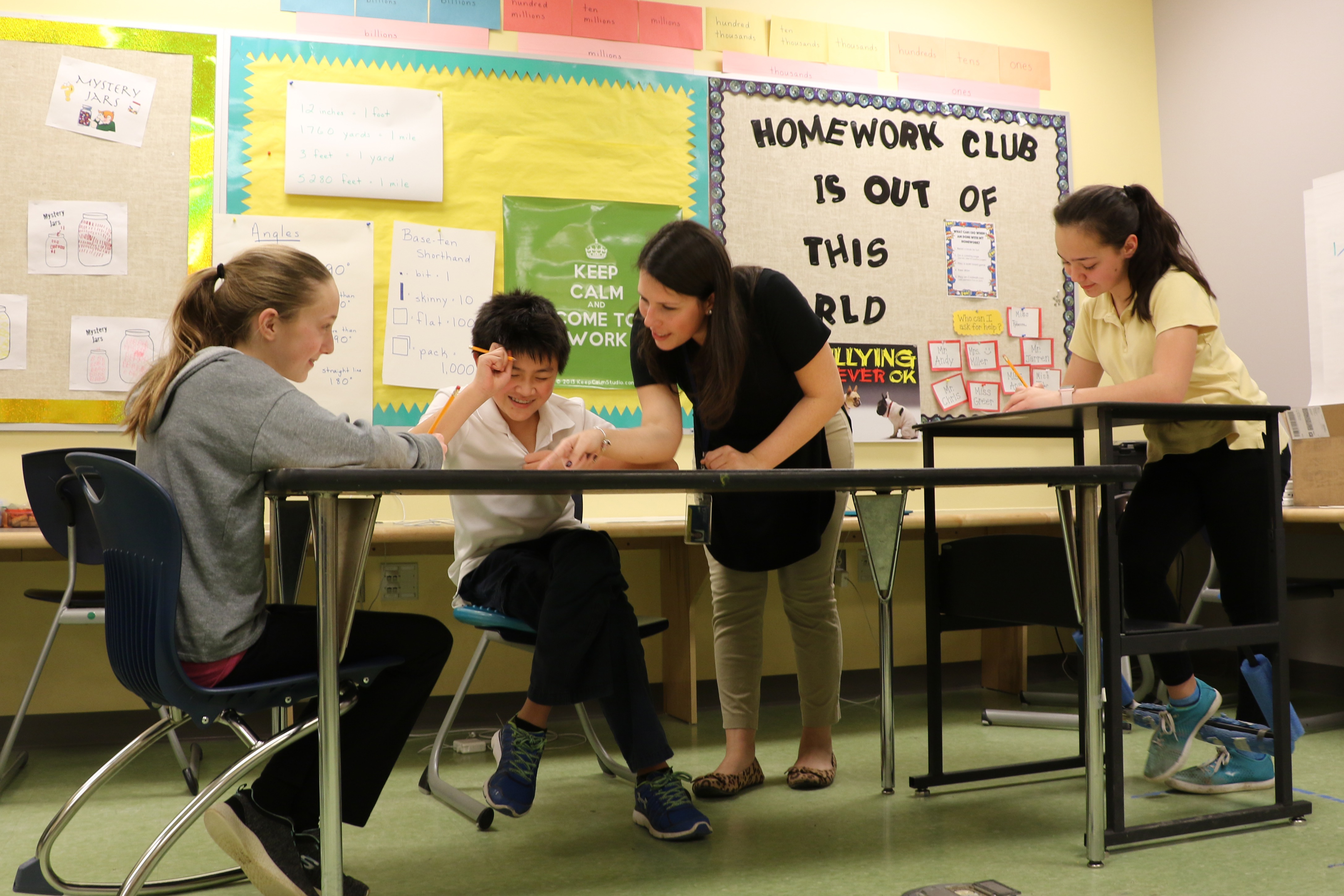 Teacher works with three students in The College School