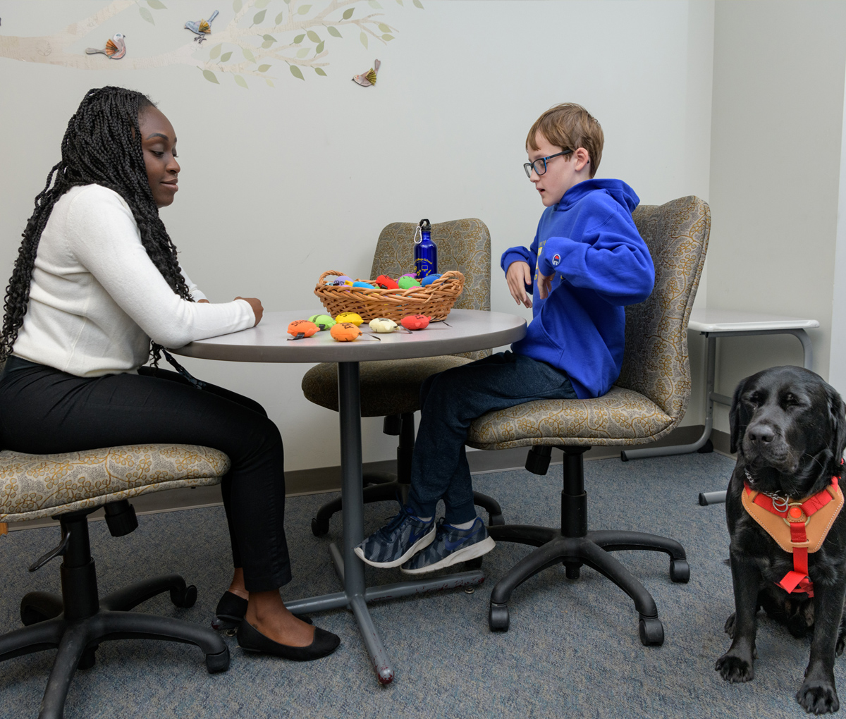 School psychologist speaks with student at The College School