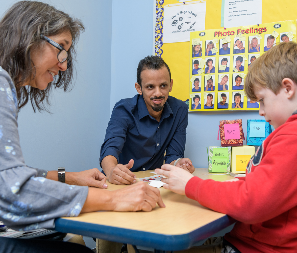Two language therapists work with a student at The College School